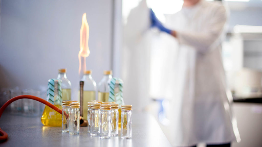 A close-up of a Bunsen burner and several small glass jars in one of our laboratories.