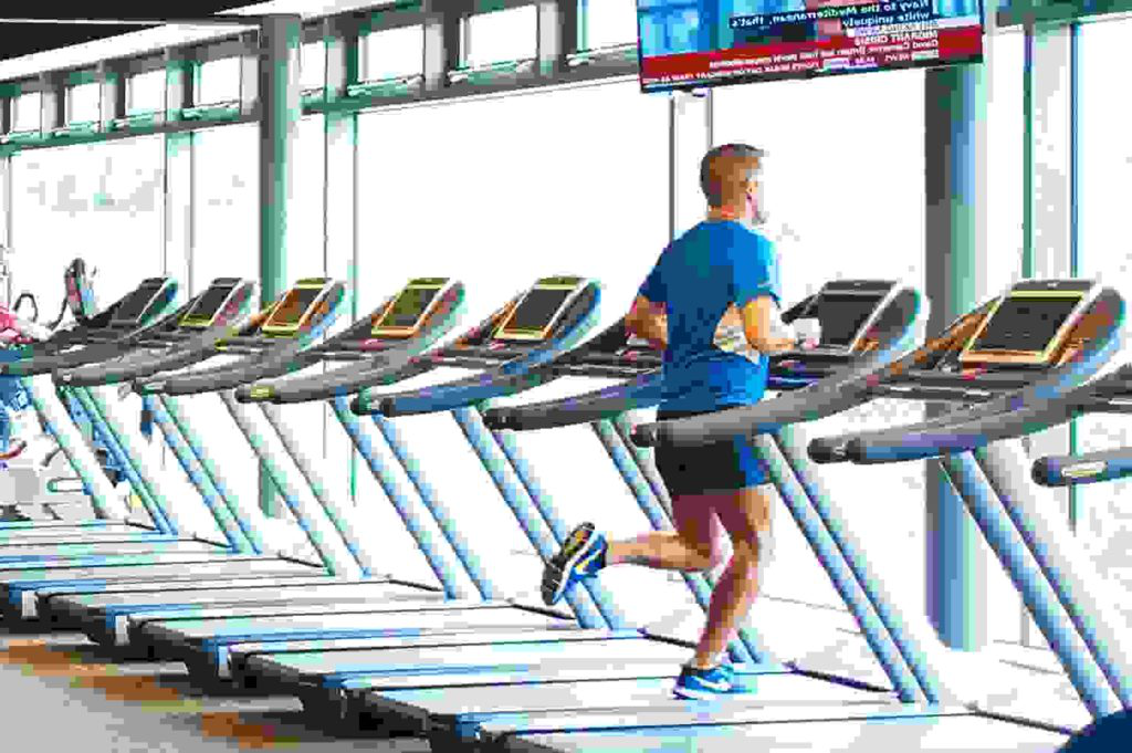Man on a treadmill in the Sports Centre