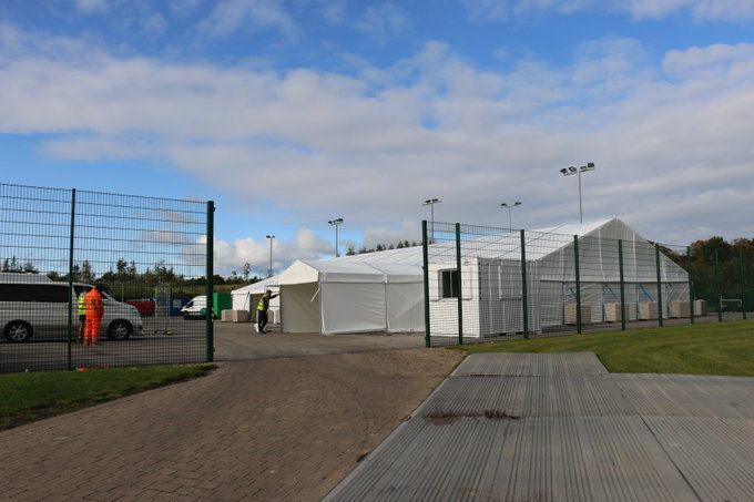 A picture of the campus test centre. It is made up of white tents.