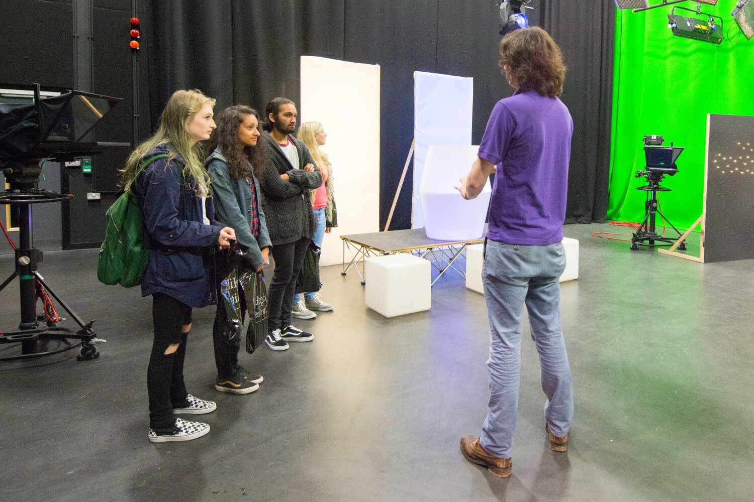 Prospective students receive a tour of the TV studio in Creative Edge during an applicant visit day.