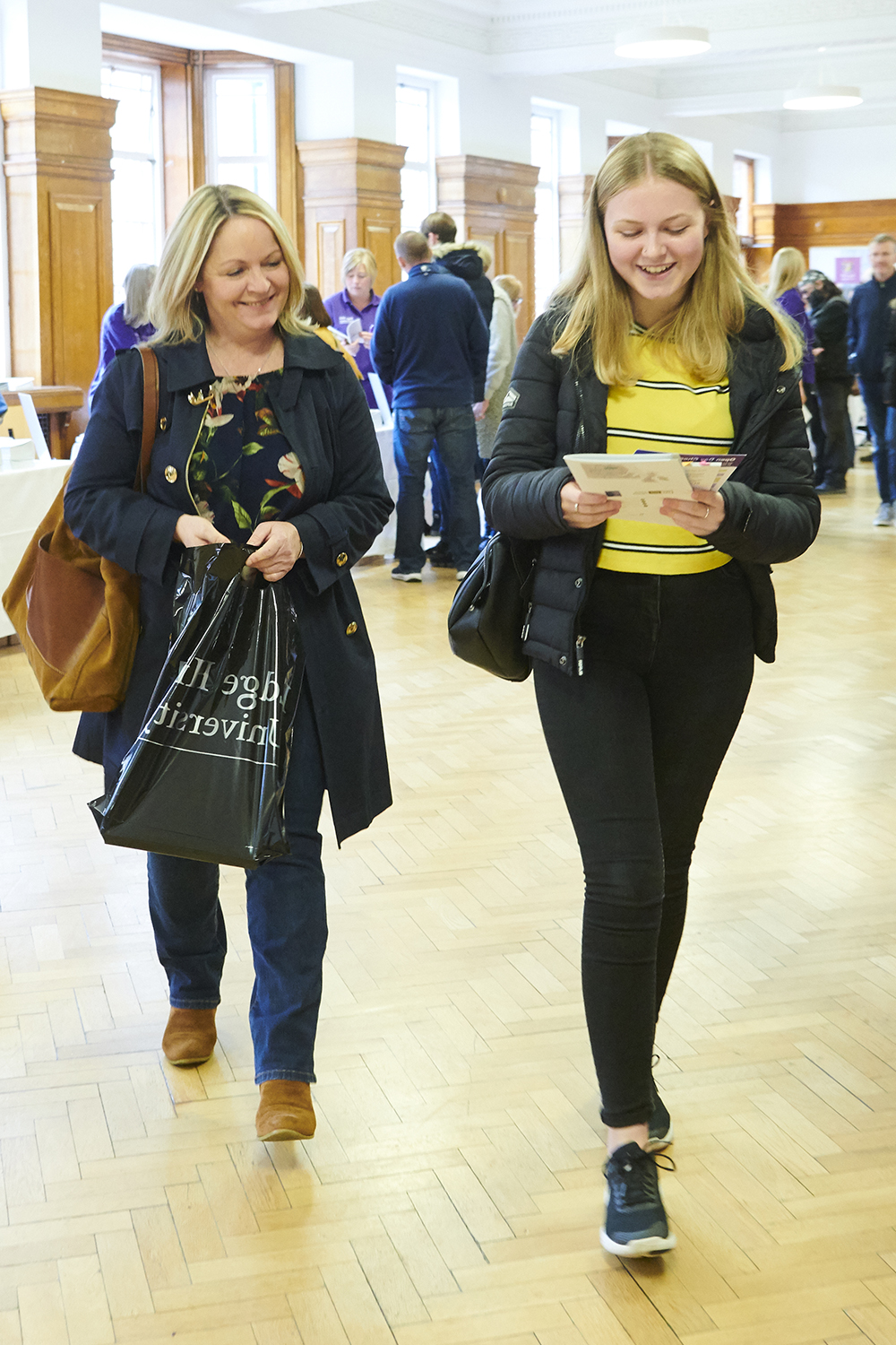 A prospective student and her mum walk through Sages Restaurant during an applicant visit day.