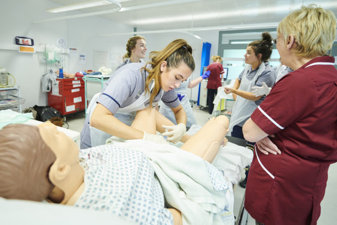 Student midwives practice their catheterisation skills.